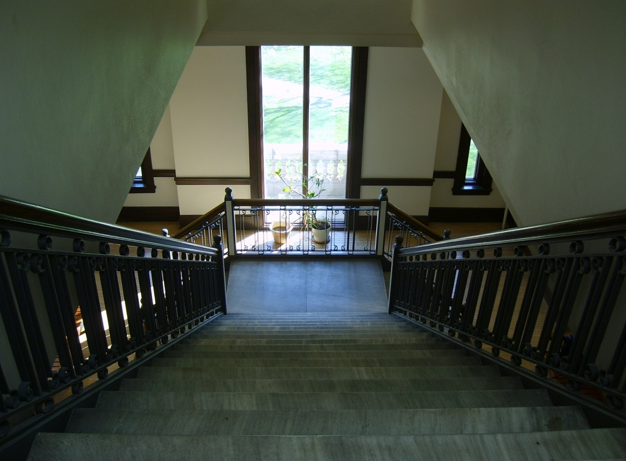 marble stairwell leading to a sunny window
