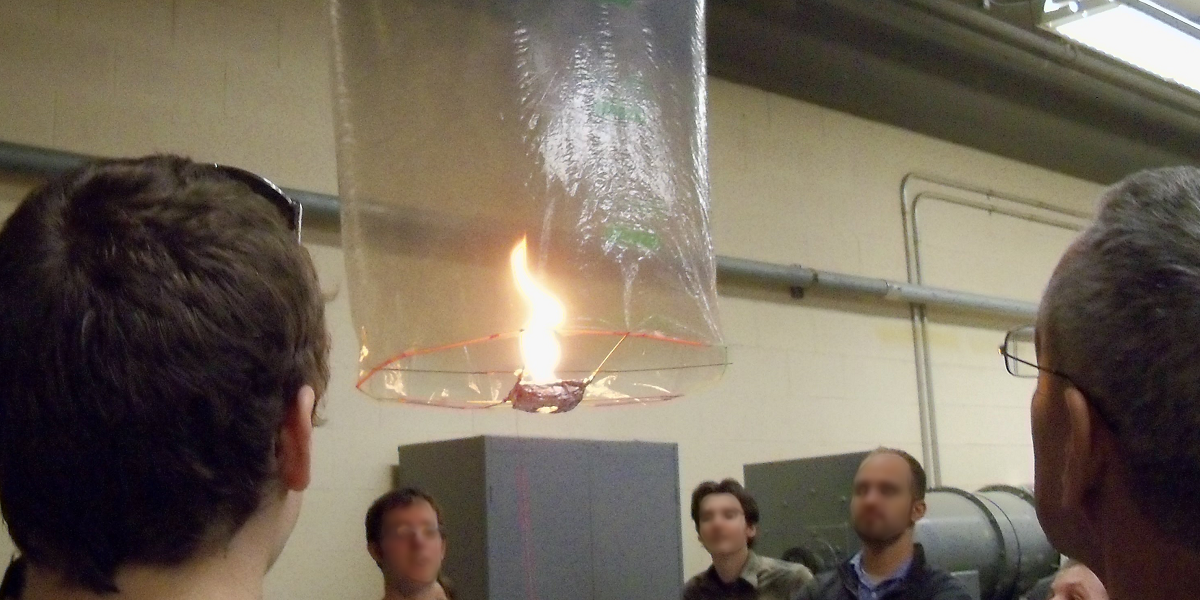 engineers watching flying fire